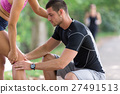 Man helps to woman with injured knee at sport 27491513