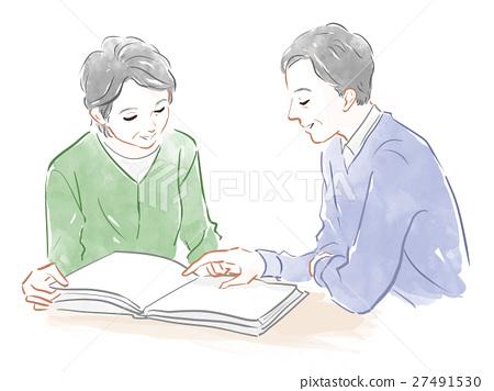 Senior generation couple looking at materials 27491530