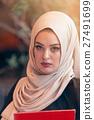 Arabian business woman holding a folder in modern 27491699