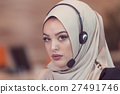 Beautiful phone operator arab woman working in 27491746