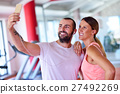 Young couple taking a sefie in a gym 27492269