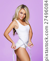Young and fit blond woman measuring her waist 27496084