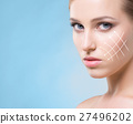 Portrait of a young woman with arrows on her face 27496202