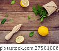 Fresh lemon and wooden juicer . 27501006