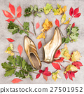 Fashion flat lay. Autumn leaves and golden shoes.  27501952