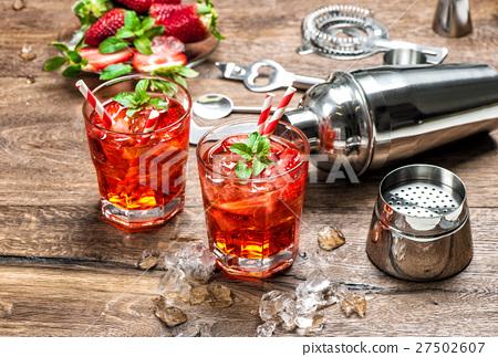 Red drink with ice. Aperitif, mojito, caipirinha, 27502607