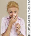 Senior Women Blowing Nose Concept 27509862