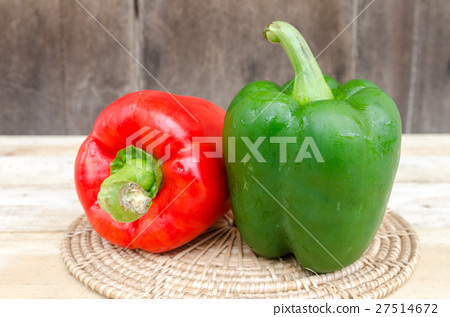 Sweet peppers on a wooden background 27514672