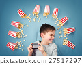 Child lying on blue background with smartphone and 27517297