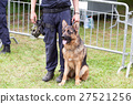 Policeman with a german shepherd on duty. 27521256