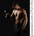 Male bodybuilder posing in studio 27521701