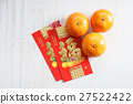 red packets and mandarin oranges 27522422