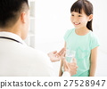 young doctor gives the child  medicine 27528947