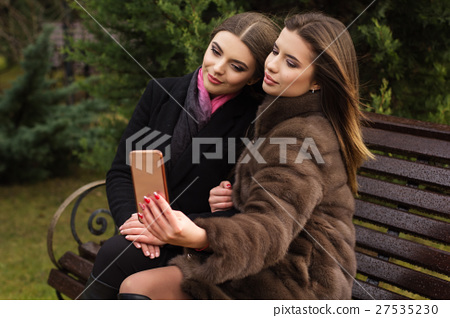 Two teen girls are taking selfie with smartphone 27535230