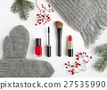 Winter cosmetics and clothes on white. Flat lay 27535990