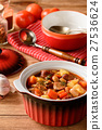 Hot soup with vegetables, smoked sausages and bean 27536624