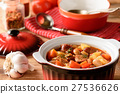Hot soup with vegetables, smoked sausages and bean 27536626