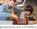 Portrait of son and father while playing chess 27540952