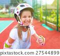Little girl in roller skates on the playground 27544899