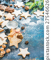 Star shaped cookies with spices, sugar powder and 27546626