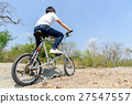 Little boy ride bicycle on the rock road. 27547557