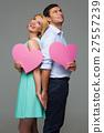 Beautiful couple holding pink hearts 27557239