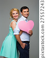Beautiful couple holding pink heart 27557243