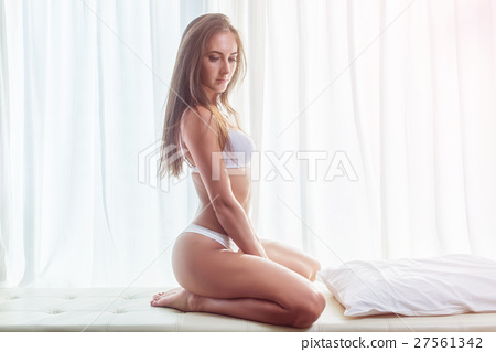 Side view of young brunette woman wearing lingerie 27561342