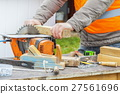 Carpenter using circular saw 27561696