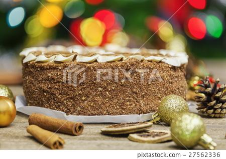 Chocolate cake near Christmas decoration close up 27562336