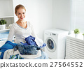 happy woman housewife in the laundry  27564552