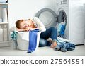 tired unhappy housewife is engaged in laundry, 27564554