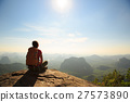 young traveler sit on the mountain peak rock   27573890