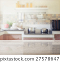 granite table top and blur of modern kitchen 27578647