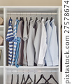 modern closet with row of shirts in wardrobe 27578674