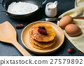 Pancakes with mulberry and honey on black stone 27579892