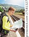 Tourist reading map 27581327