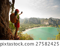 woman hiker enjoy the view on mountain cliff 27582425