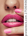 Close up pink lips and nails 27590406