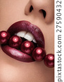 Close up mouth with red pearls and lipstick 27590432