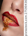 Close up lips with red and gold make up 27590436
