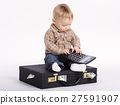 young bookkeeper with suitcase of money 27591907