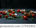 Fresh tomatoes in cracked eggshell on black stone 27592802