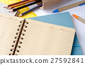 Blank notebook with school supplies on white table 27592841