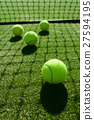 selective focus. tennis ball back light shadow on  27594195