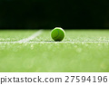 selective focus. tennis ball on tennis grass court 27594196