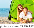 Happy young couple camping on the beach 27594437