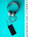 Gray vintage headphones and cellphone. 27594817