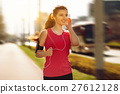 Young beautiful woman running in the city 27612128