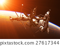 Space Shuttle And Space Station In The Rays Of Sun 27617344